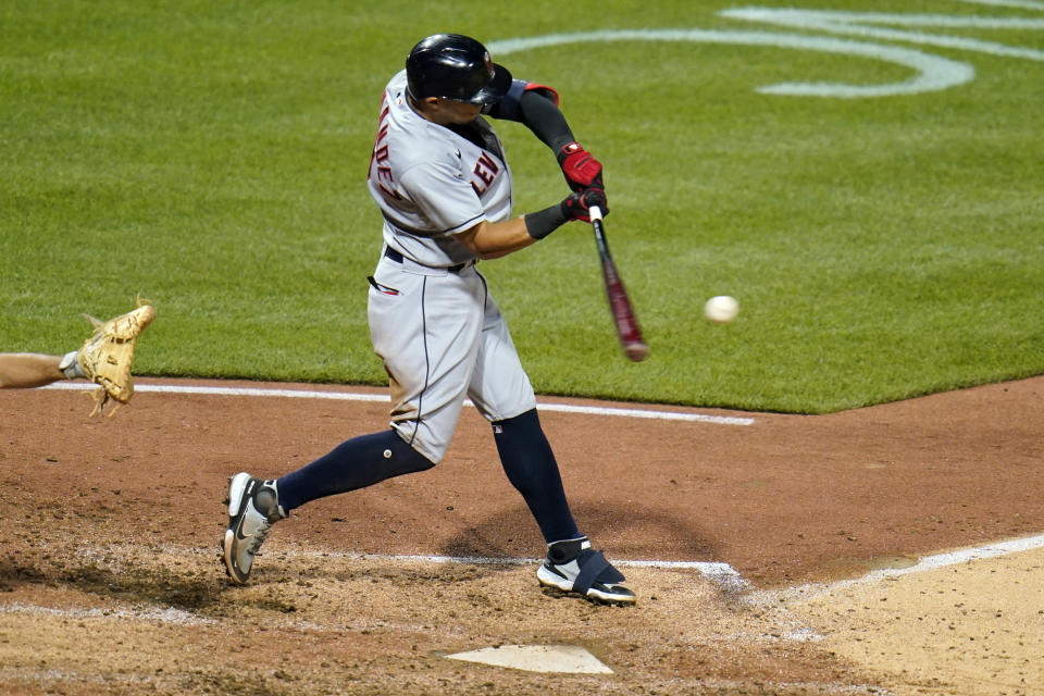 Cleveland Indians' Cesar Hernandez hits a grand slam off Pittsburgh Pirates relief pitcher Sam Howard during the seventh inning of a baseball game in Pittsburgh, Friday, June 18, 2021. (AP Photo/Gene J. Puskar)