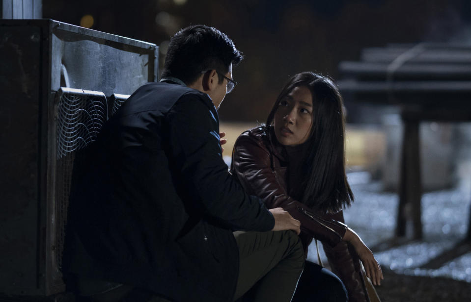 """This image released by The CW shows Jon Prasida as Ryan Shen, left, and Olivia Liang as Nicky Shen in a scene from """"Kung Fu,"""" premiering on April 7. (Kailey Schwerman/The CW via AP)"""