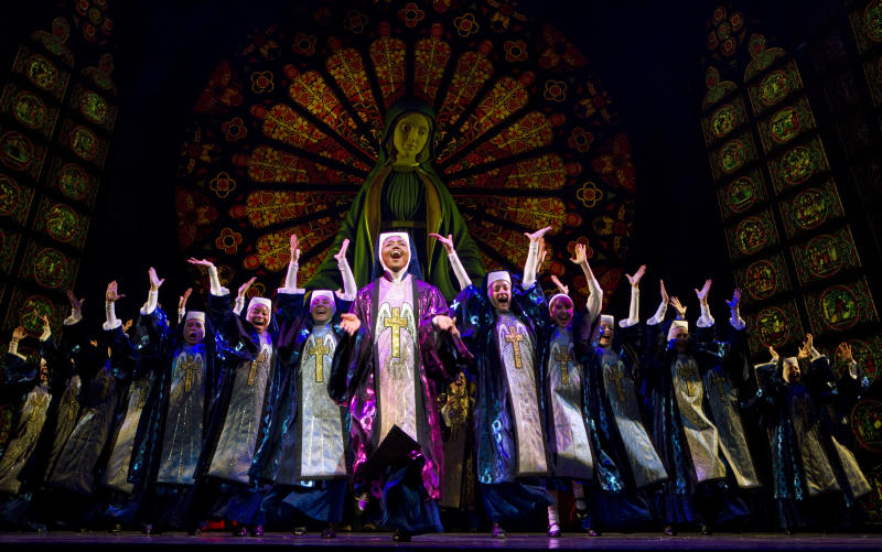 """In this theater publicity image released by The Hartman Group, Patina Miller, center, is shown in a scene from the Broadway musical """"Sister Act,"""" in New York. The production is nominated for a Tony Award.  The Tony Awards will be broadcast live on Sunday June 12. (AP Photo/The Harman Group, Joan Marcus)"""