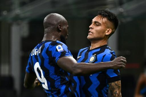 Lautaro Martinez (R) secured victory for Inter Milan as they reclaimed second place in Serie A