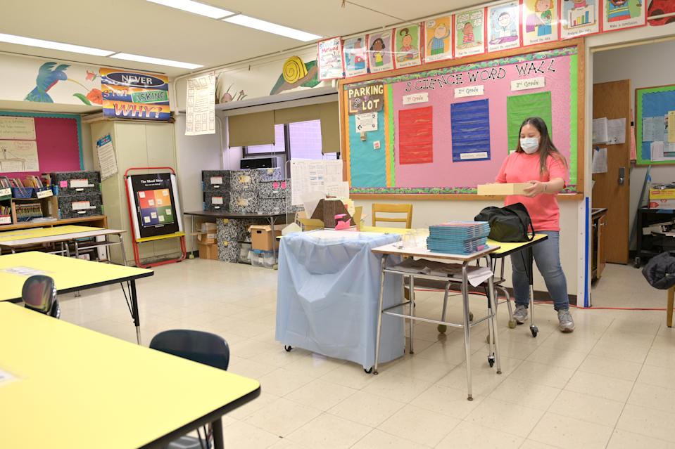 Schoolteacher Melissa Wong packs up the classroom that she appropriated for virtual teaching just a couple of months earlier on November 19, 2020 at Yung Wing School P.S. 124 in New York City. (Michael Loccisano/Getty Images)