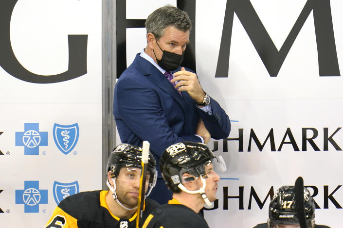 Pittsburgh Penguins head coach Mike Sullivan stands behind his bench during the third period of an NHL hockey game against the Washington Capitals in Pittsburgh, Sunday, Jan. 17, 2021. (AP Photo/Gene J. Puskar)