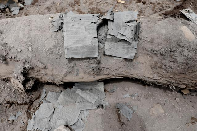 <p>Pages of a burned Bible are seen in an area affected by the eruption of the Fuego volcano in San Miguel Los Lotes in Escuintla, Guatemala, June 8, 2018. (Photo: Carlos Jasso/Reuters) </p>