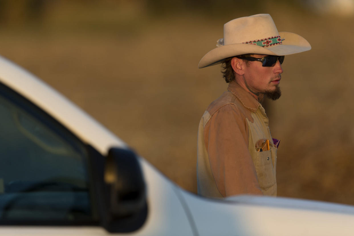 Johnnie Langendorff, who pursued the suspect of the Sutherland Springs First Baptist Church church shooting, waits to be picked up from the scene where the suspect died near the intersection of FM 539 and Sandy Elm Road in Guadalupe County on Nov. 5, 2017. (Photo: William Luther/San Antonio Express-News via ZUMA Wire)