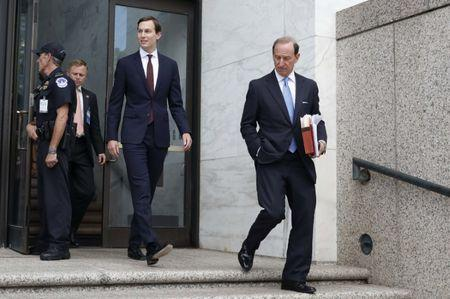 White House Senior Adviser Jared Kushner (C) and his attorney Abe Lowell (R) depart following Kushner's appearance before a closed session of the Senate Intelligence Committee as part of their probe into Russian meddling in the 2016 U.S. presidential election, on Capitol Hill in Washington, U.S. July 24, 2017. REUTERS/Aaron P. Bernstein