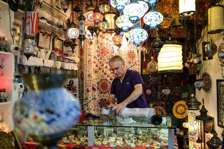 A shopkeeper wraps a lamp for a customer in his shop in the coastal city of Kyrenia in the Turkish Republic of Northern Cyprus (TRNC), which is only recognised by Turkey
