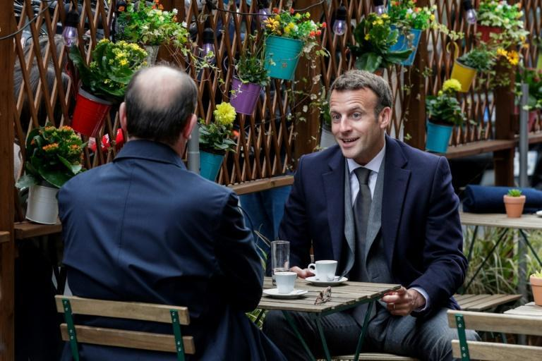 President Emmanuel Macron and Prime Minister Jean Castex enjoy a first coffee at a cafe close to the presidential palace