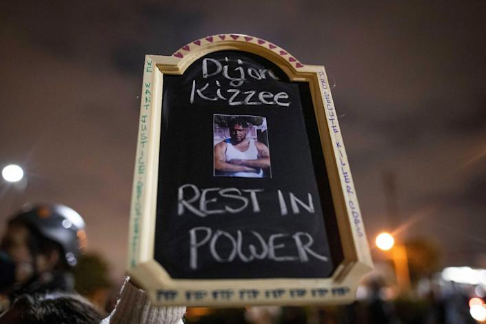 A protester holds a picture of Dijon Kizzee, who died after being shot by Los Angeles sheriff's deputies on Aug. 31.