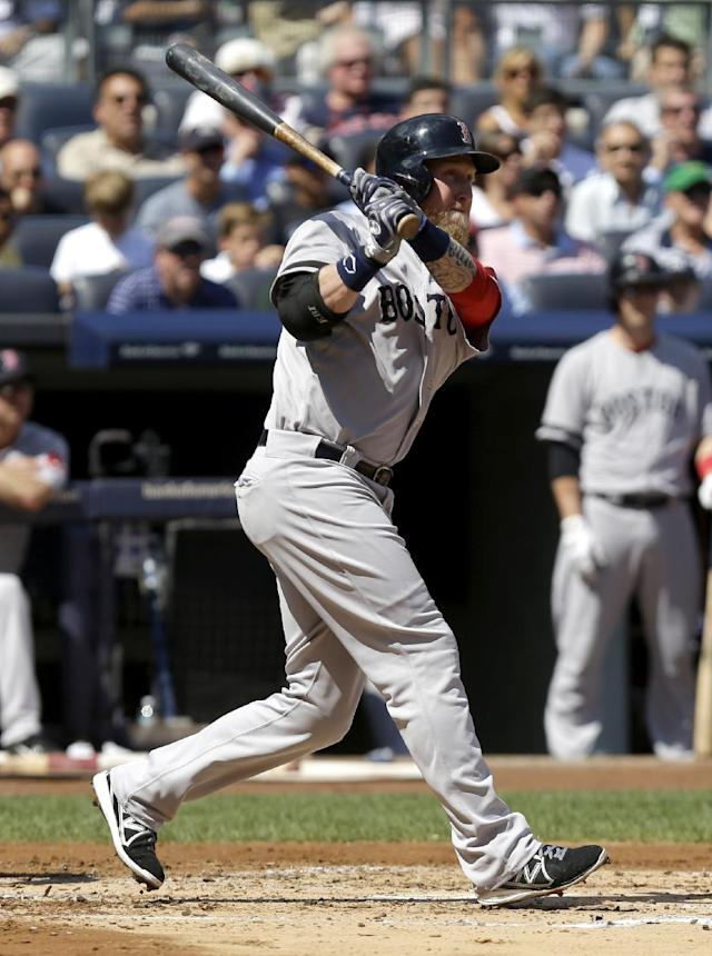 Boston Red Sox's Mike Carp hits an RBI-double during the second inning of a baseball game against the New York Yankees at Yankee Stadium, Sunday, Sept. 8, 2013 in New York. (AP Photo/Seth Wenig)