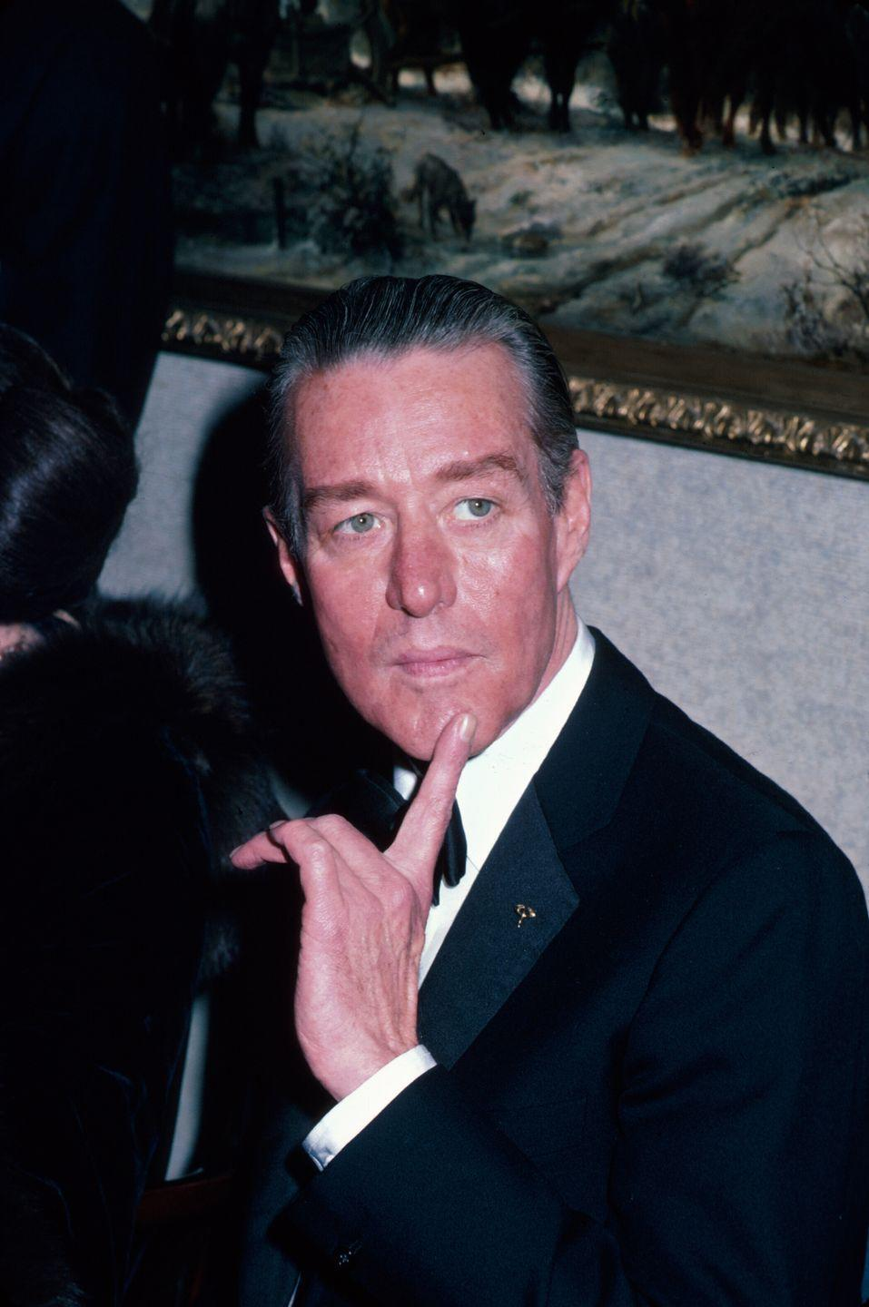 """<p>The fashion designer is shown here in one of his last portraits before going into seclusion. Halston's brother, Robert Frowick, <a href=""""https://apnews.com/article/85a6d4cf602bb5359acee5373566f30d"""" rel=""""nofollow noopener"""" target=""""_blank"""" data-ylk=""""slk:told the Associated Press"""" class=""""link rapid-noclick-resp"""">told the Associated Press</a> that the designer spent his final months visiting with his siblings and driving the California coast in his beloved Rolls Royce. He died in San Francisco on <a href=""""https://apnews.com/article/85a6d4cf602bb5359acee5373566f30d"""" rel=""""nofollow noopener"""" target=""""_blank"""" data-ylk=""""slk:March 26, 1990"""" class=""""link rapid-noclick-resp"""">March 26, 1990</a> of AIDS-related cancer. He was 57.</p>"""