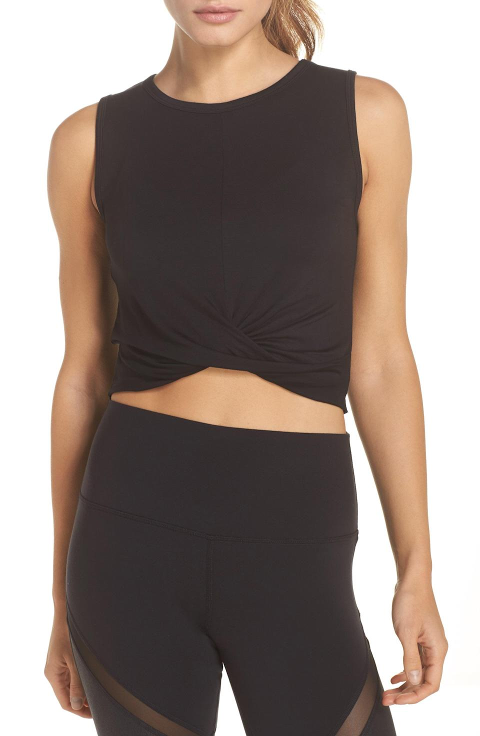 """<p><strong>ALO</strong></p><p>nordstrom.com</p><p><strong>$54.00</strong></p><p><a href=""""https://go.redirectingat.com?id=74968X1596630&url=https%3A%2F%2Fwww.nordstrom.com%2Fs%2Falo-cover-tank%2F4858336&sref=https%3A%2F%2Fwww.prevention.com%2Ffitness%2Fworkout-clothes-gear%2Fg37542513%2Fworkout-tops-for-women%2F"""" rel=""""nofollow noopener"""" target=""""_blank"""" data-ylk=""""slk:Shop Now"""" class=""""link rapid-noclick-resp"""">Shop Now</a></p><p>Stand out from the gym crowd in this bright faux wrap tank. It <strong>features a fitted silhouette that hits at the waist, a soft draped jersey fabric, and a raw edge hem</strong>. """"The material is nice, the color is pretty, the style is very flattering, and it fits perfect,"""" wrote one Nordstrom shopper.</p>"""