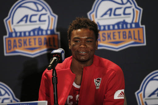 North Carolina State basketball player Markell Johnson answers a question during the Atlantic Coast Conference NCAA college basketball media day in Charlotte, N.C., Tuesday, Oct. 8, 2019. (AP Photo/Nell Redmond)