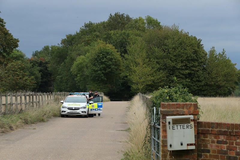 Police at Courtlands Farm in Banstead, Surrey: PA