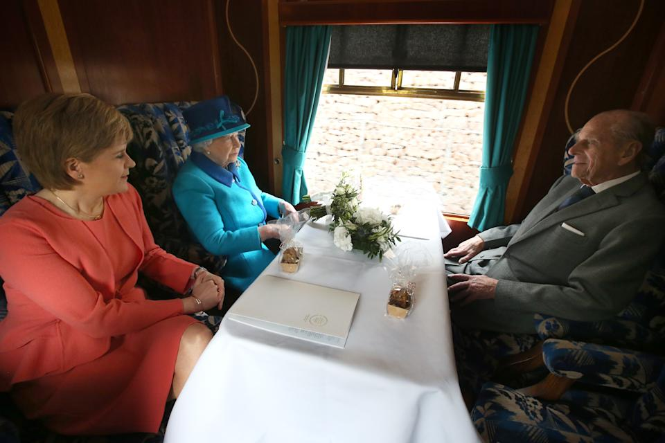 EDINBURGH, SCOTLAND - SEPTEMBER 09:   First Minister of Scotland Nicola Sturgeon, Queen Elizabeth II and Prince Philip, Duke of Edinburgh on board the steam locomotive 'Union of South Africa' on the day she becomes Britain's longest reigning monarch on September 09, 2015 in Edinburgh, Scotland. Today, Her Majesty Queen Elizabeth II becomes the longest reigning monarch in British history overtaking her great-great grandmother Queen Victoria's record by one day. The Queen has reigned for a total of 63 years and 217 days. Accompanied by her husband and Scotland's First Minister Nicola Sturgeon she will officially open the new Scottish Border's Railway which runs from the capital to Tweedbank.  (Photo by Andrew Milligan - WPA Pool/Getty Images)