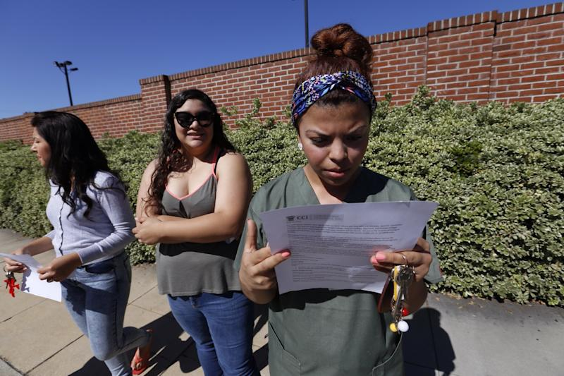 ALHAMBRA, CA - APRIL 27: Ruby Maldanado, 20, a Medical Assistant student checks a note handed out to students that have been turned away at the gate to Everest College on April 27, 2015 in Alhambra, California. Corinthian Colleges Inc., a Santa Ana company that was once one of the nation's largest for-profit college chains, announced that it would be shutting down its remaining two dozen schools effective - a move that leaves 16,000 students scrambling for alternatives. (Photo by Al Seib / Los Angeles Times via Getty Images)