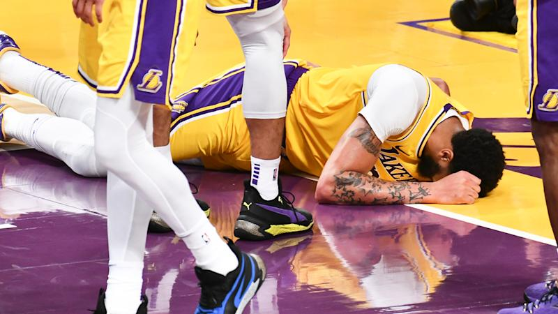 Los Angeles Lakers star Anthony Davis is pictured after taking a hard fall on his tail bone.