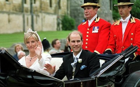 Prince Edward and Sophie Rhys-Jones pictured in their carriage after their wedding in 1999 - Credit: EPA
