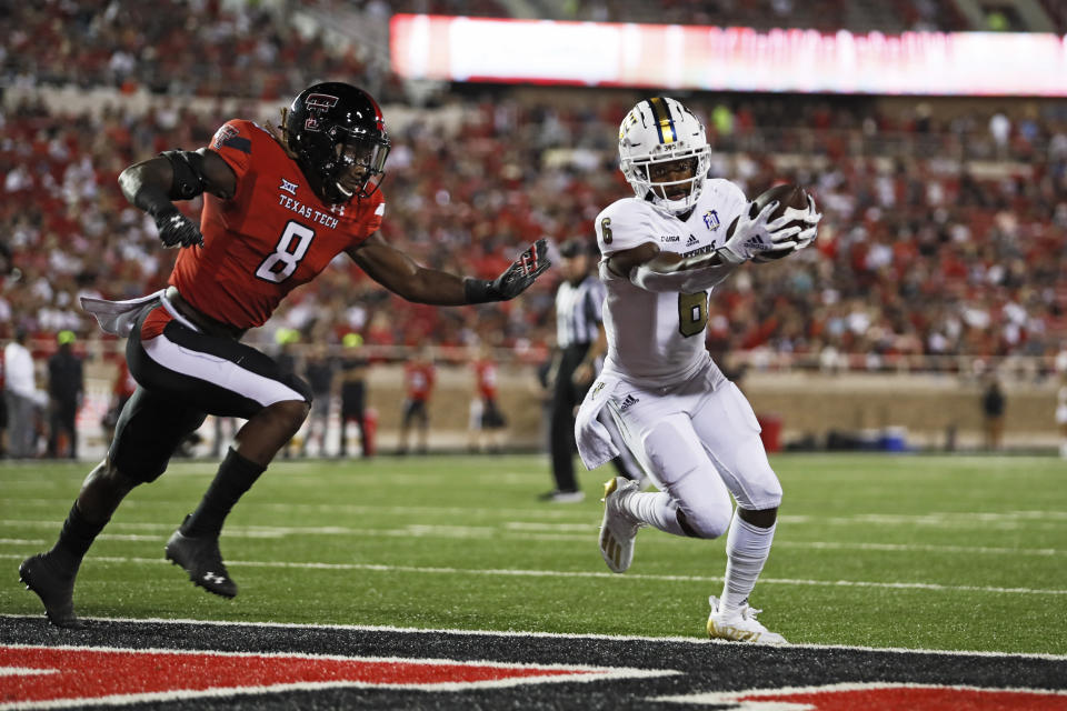 Florida International's Nate Jefferson (6) scores a touchdown around Texas Tech's Malik Dunlap (8) during the second half of an NCAA college football game on Saturday, Sept. 18, 2021, in Lubbock, Texas. (AP Photo/Brad Tollefson)