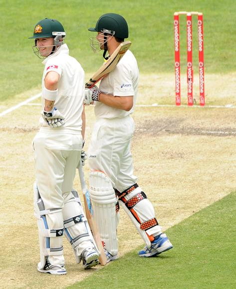 Michael Clarke (L) of Australia looks on during day four of the First Test match between Australia and South Africa at The Gabba on November 12, 2012 in Brisbane, Australia.  (Photo by Matt Roberts/Getty Images)