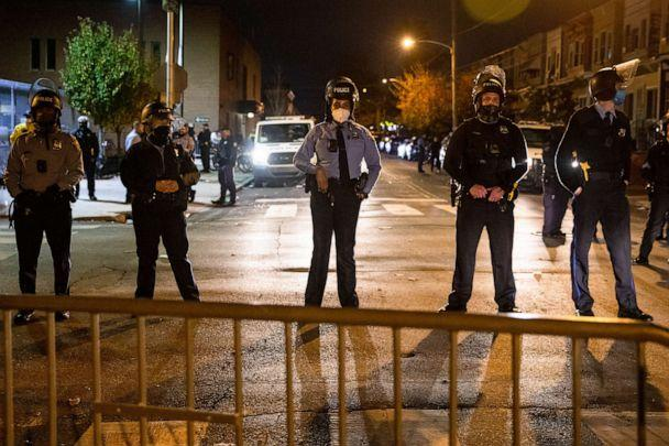 PHOTO: TOPSHOT - Police line up to protect the 18th Police Precinct after the city imposed a 9pm curfew in Philadelphia, October 28, 2020, following two nights of protesting and unrest after the fatal shooting of Walter Wallace Jr.  (Gabriella Audi/AFP via Getty Images)