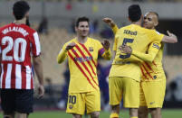 Barcelona players celebrate after winning the Spanish Copa del Rey final 2021 against Athletic Bilbao at La Cartuja stadium in Seville, Spain, Saturday April 17, 2021. (AP Photo/Angel Fernandez)