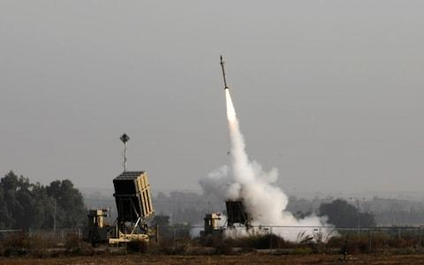 An Israeli missile launched from the Iron Dome defence missile system, designed to intercept and destroy incoming short-range rockets and artillery shells - Credit: AFP