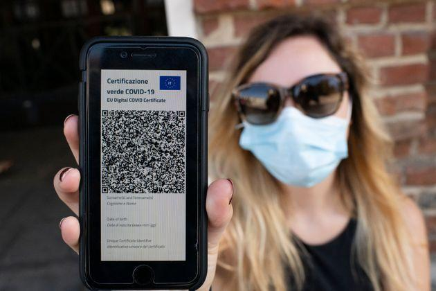 TURIN, ITALY - JUNE 30: A woman shows Italy's Covid-19 Green Pass for post-vaccine travel on a smartphone on June 30, 2021 in Turin, Italy. The digital health certificate, or Green Pass, was officially launched by Italian Prime Minister Draghi, allowing people to access certain events and facilities in Italy as well as travel domestically and abroad. (Photo by Stefano Guidi/Getty Images) (Photo: Stefano Guidi via Getty Images)