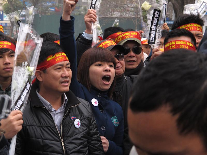 Anti-China protestors rally in the Vietnamese capital Sunday, Feb. 16, 2014 to mark the 35th anniversary of a border war between Vietnam and China. Vietnam is wary of all forms of public protest and often quashes anti-China gatherings (AP Photo/Chris Brummitt)