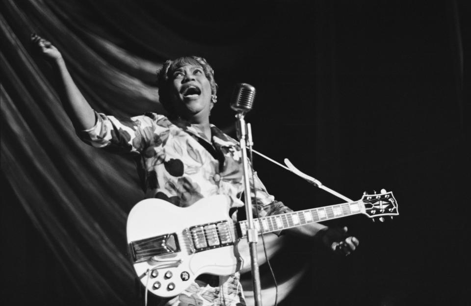 American gospel singer Sister Rosetta Tharpe (1915 - 1973) performs at a Blues and Gospel Caravan tour in the UK, 1964. (Photo: Tony Evans/Getty Images)