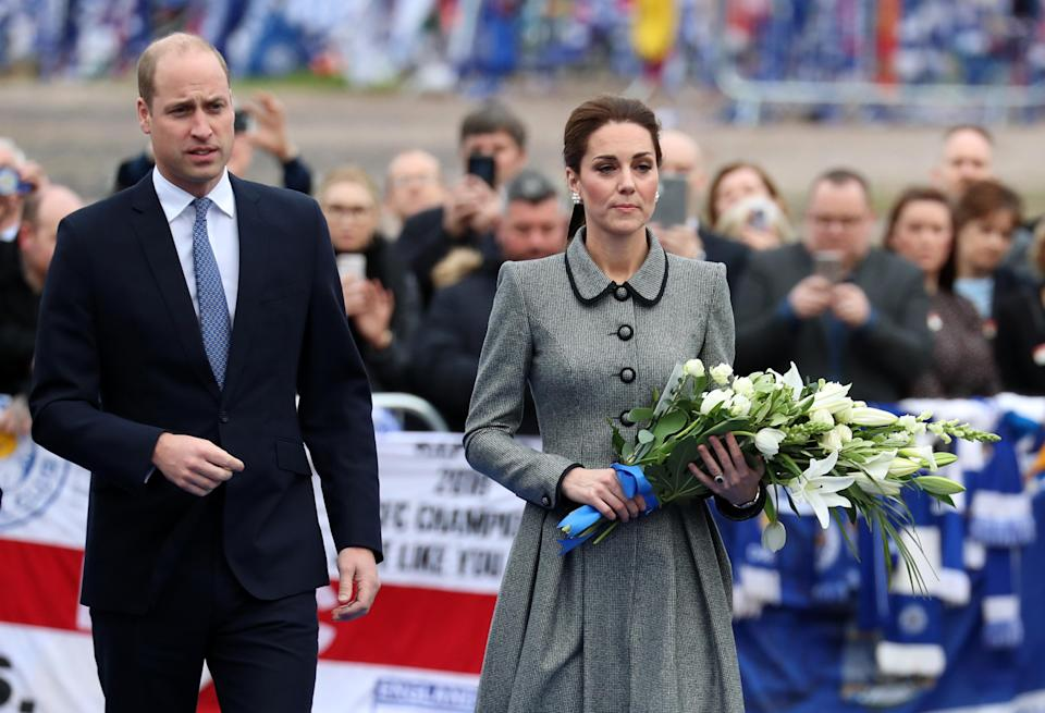 William and Kate pay their respects (Photo: Getty)