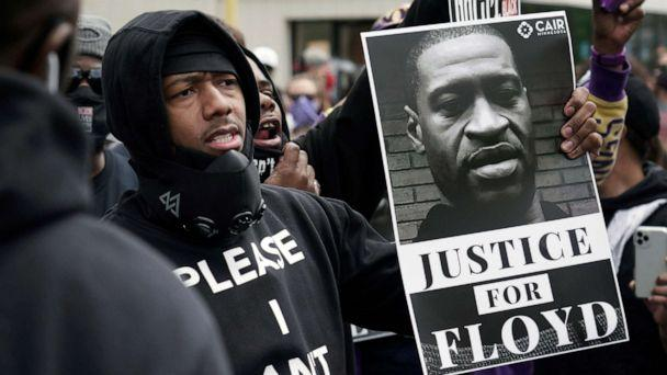 PHOTO: Actor and comedian Nick Cannon celebrates the memory of George Floyd and demand justice outside the Cup Foods store on Chicago Avenue, Friday, May 29, 2020 in Minneapolis. (Brian Peterson/AP Photo)