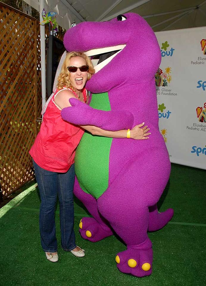 "Is Barney trying to hug actress Virginia Madsen, or bite her head off? Mark Sullivan/<a href=""http://www.wireimage.com"" target=""new"">WireImage.com</a> - June 8, 2008"