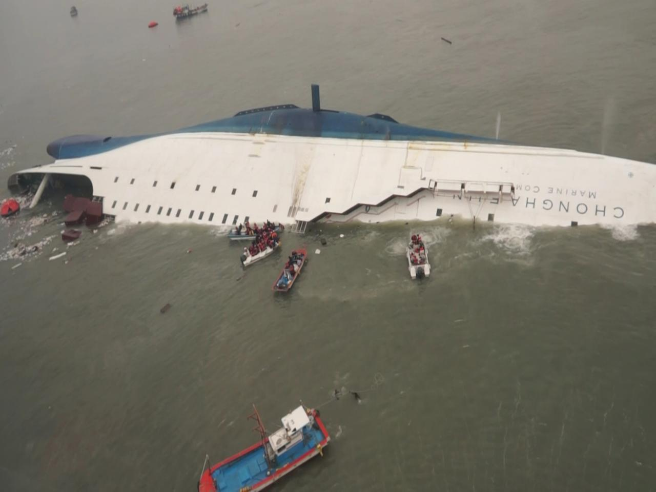 "South Korean ferry ""Sewol"" is seen sinking in the sea off Jindo April 16, 2014, in this picture provided by Korea Coast Guard and released by Yonhap. Almost 300 people were missing after a ferry sank off South Korea on Wednesday, the coastguard said, in what could be the country's biggest peacetime disaster in nearly 20 years. REUTERS/Korea Coast Guard/Yonhap (SOUTH KOREA - Tags: DISASTER) ATTENTION EDITORS - NO SALES. NO ARCHIVES. FOR EDITORIAL USE ONLY. NOT FOR SALE FOR MARKETING OR ADVERTISING CAMPAIGNS. THIS IMAGE HAS BEEN SUPPLIED BY A THIRD PARTY. IT IS DISTRIBUTED, EXACTLY AS RECEIVED BY REUTERS, AS A SERVICE TO CLIENTS. SOUTH KOREA OUT. NO COMMERCIAL OR EDITORIAL SALES IN SOUTH KOREA"