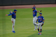 New York Mets outfielders Khalil Lee (26) Dominic Smith, left, and Johneshwy Fargas (81) celebrate the team's 4-3 win over the Atlanta Braves in a baseball game Tuesday, May 18, 2021, in Atlanta. (AP Photo/John Bazemore)