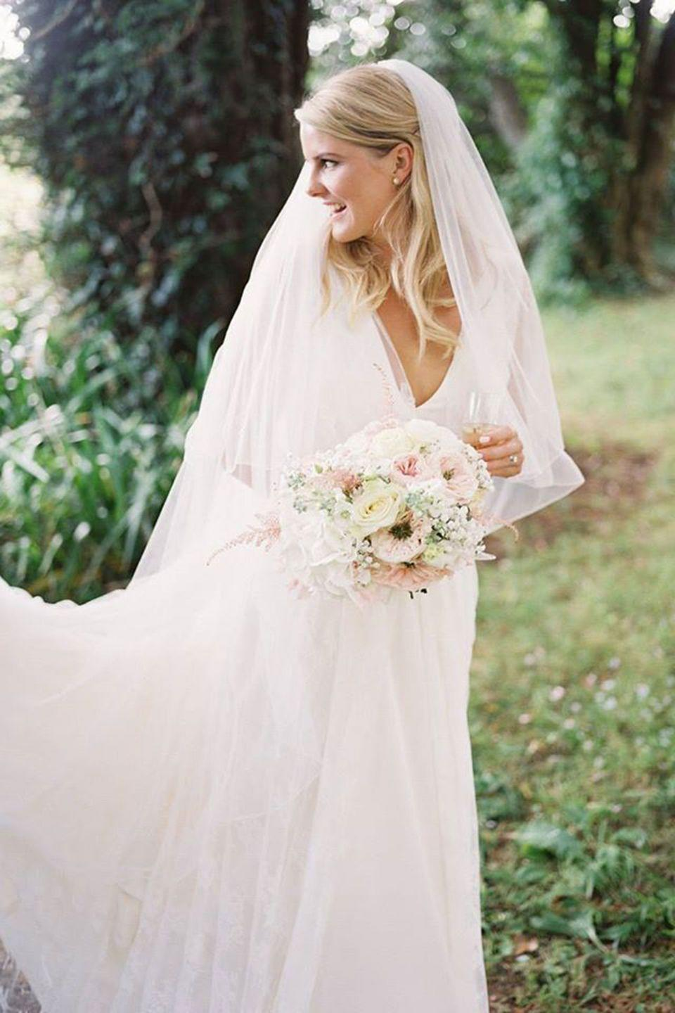<p><strong>Wedding dress and veil</strong>: Charlie Brear</p><p><strong>Shoes</strong>: Jimmy Choo</p><p><strong>Rings</strong>: 77 diamonds</p>