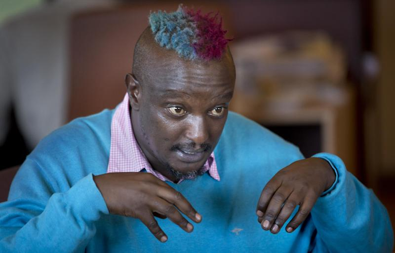 Prize-winning Kenyan author Binyavanga Wainaina talks during a television interview in Nairobi, Kenya Wednesday, Jan. 22, 2014. Wainaina, one of Africa's leading literary figures, spoke to The Associated Press on Wednesday to explain his decision to publicly declare his homosexuality in an online essay last weekend, in light of a wave of new legislation further criminalizing homosexuality in Nigeria and Uganda. (AP Photo/Ben Curtis)