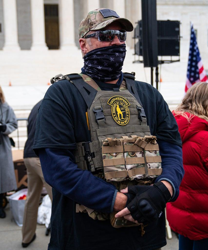 WASHINGTON, DC – JANUARY 05: A member of the right-wing group Oath Keepers stands guard during a rally in front of the U.S. Supreme Court Building on January 5, 2021 in Washington, DC. Today's rally kicks off two days of pro-Trump events fueled by President Trump's continued claims of election fraud and a last-ditch effort to overturn the results before Congress finalizes them on January 6. (Photo by Robert Nickelsberg/Getty Images)