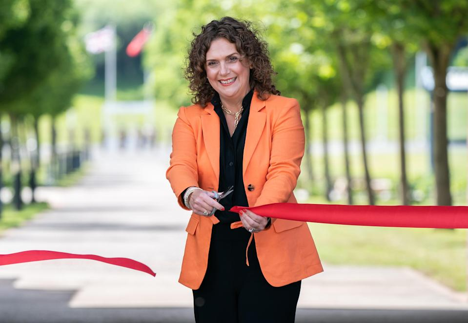 Captain Sir Tom Moore's daughter Hannah Ingram-Moore cuts a ribbon to officially open the walkway (PA Wire)