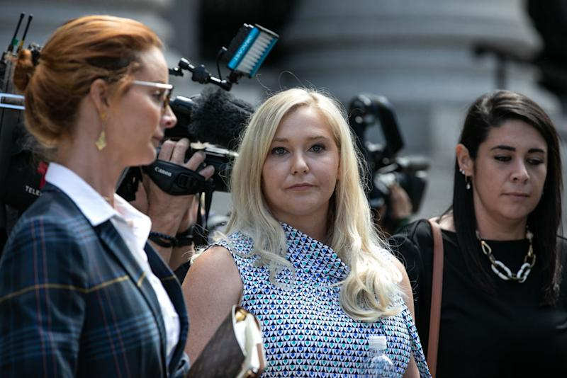 Virginia Giuffre, an alleged victim of Jeffrey Epstein, center, exits from federal court in New York, U.S., on Tuesday, Aug. 27, 2019. | Jeenah Moon—Bloomberg via Getty Images