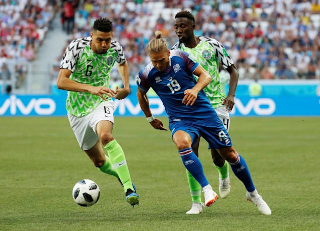 Soccer Football - World Cup - Group D - Nigeria vs Iceland - Volgograd Arena, Volgograd, Russia - June 22, 2018 Iceland's Rurik Gislason in action with Nigeria's Leon Balogun and Wilfred Ndidi REUTERS/Toru Hanai