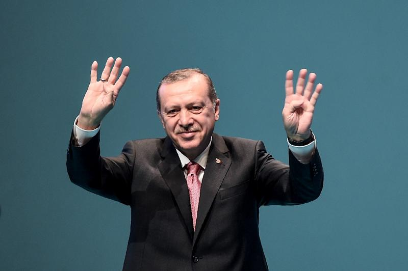 Turkish President Recep Tayyip Erdogan waves after delivering a speech in Istanbul, on March 3, 2017