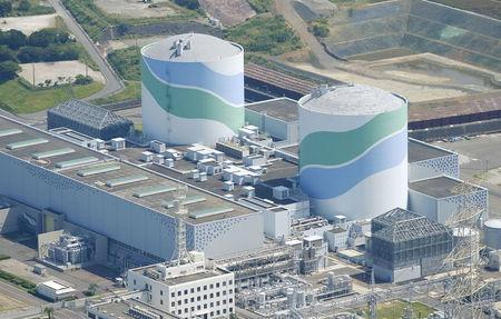 An aerial view shows the No.1 (L) and No.2 reactor buildings at Kyushu Electric Power's Sendai nuclear power station in Satsumasendai, Kagoshima prefecture, Japan, August 11, 2015, in this photo taken by Kyodo. REUTERS/Kyodo