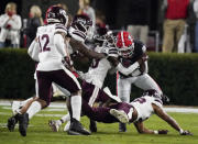 Georgia wide receiver Jermaine Burton is tackled by Mississippi State cornerback Emmanuel Forbes during the first half during an NCAA college football game Saturday, Nov. 21, 2020, in Athens, Ga. (AP Photo/Brynn Anderson)