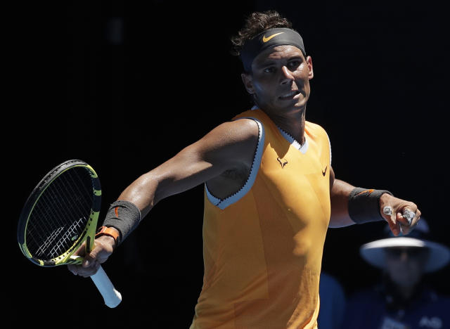 Spain's Rafael Nadal reacts after winning a point against Australia's James Duckworth during their first round match at the Australian Open tennis championships in Melbourne, Australia, Monday, Jan. 14, 2019. (AP Photo/Aaron Favila)