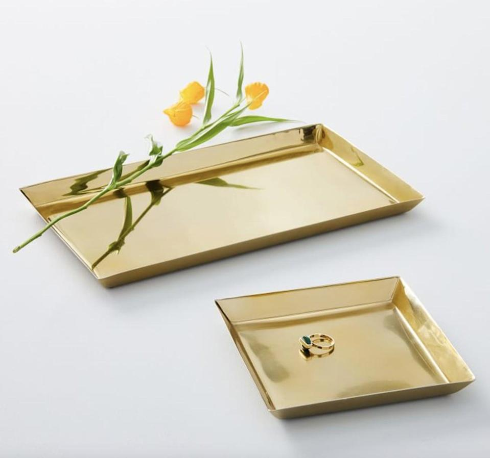 <p>This <span>West Elm Foundations Brass Tray</span> ($18, originally $20) will bring a polished touch to their dresser.</p>