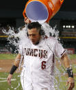 Arizona Diamondbacks' David Peralta gets a shower after hitting a single to defeat the Los Angeles Dodgers 3-2 during a baseball game Wednesday, June 5, 2019, in Phoenix. (AP Photo/Rick Scuteri)