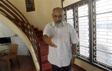 C.V.Wigneswaran, Chief Minister candidate from the Tamil National Alliance, talks to foreign media as he arrives for an interview at his party office in Jaffna