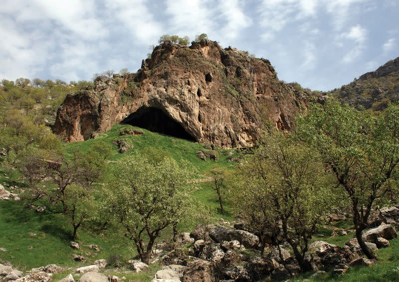 View of the entrance to Shanidar Cave in the foothills of the Baradost Mountains in Iraq's northern Kurdistan region