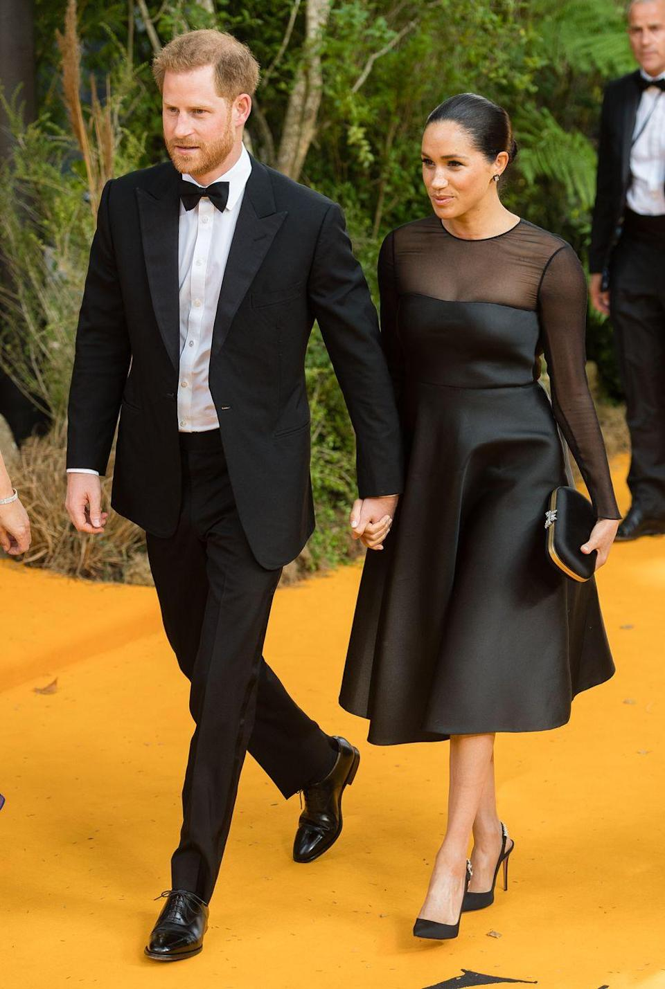 "<p><a href=""https://www.harpersbazaar.com/uk/celebrities/red-carpet/a28389300/duchess-of-sussex-attends-the-lion-king-london-premiere/"" rel=""nofollow noopener"" target=""_blank"" data-ylk=""slk:The royals walked the red carpet together"" class=""link rapid-noclick-resp"">The royals walked the red carpet together</a> at the London premiere of The Lion King, where they met with Beyoncé & Jay-Z, as well as Elton John. Meghan, in her first red-carpet appearance after giving birth, wore a black Jason Wu dress with timeless Aquazzura slingback pumps, while Harry was dapper in a tux and bow-tie. </p>"