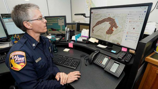 PHOTO: In this July 23, 2021, file photo, Cal Fire Capt. Danell Eshnaur uses the Fire Response Tactical Analyst program to help pre-position fire fighting resources on the Dixie Fire at the Cal Fire's Sacramento Command Center in Rancho Cordova, Calif. (Rich Pedroncelli/AP, FILE)
